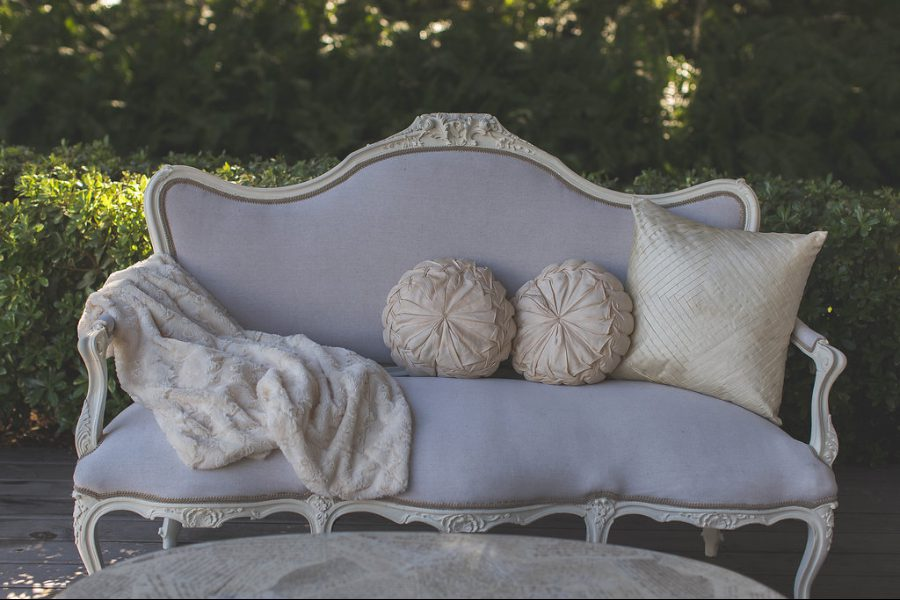 French Country Style Sofa On The Front Porch Of The Chapel.