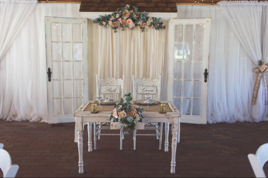 French Doors And A Floral Arrangement Made For An Elegant Backdrop Behind Their Sweetheart Table