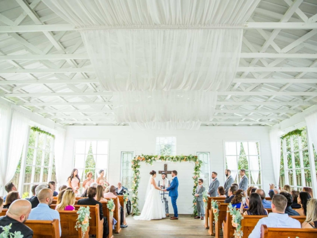 Couple getting married at the Chapel site at Carriage House Stable