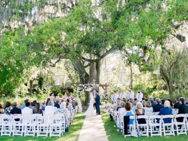The Grandfather Oak is a wedding ceremony site at Cross Creek Ranch under an old, majestic oak tree draped with wisps of Spanish moss