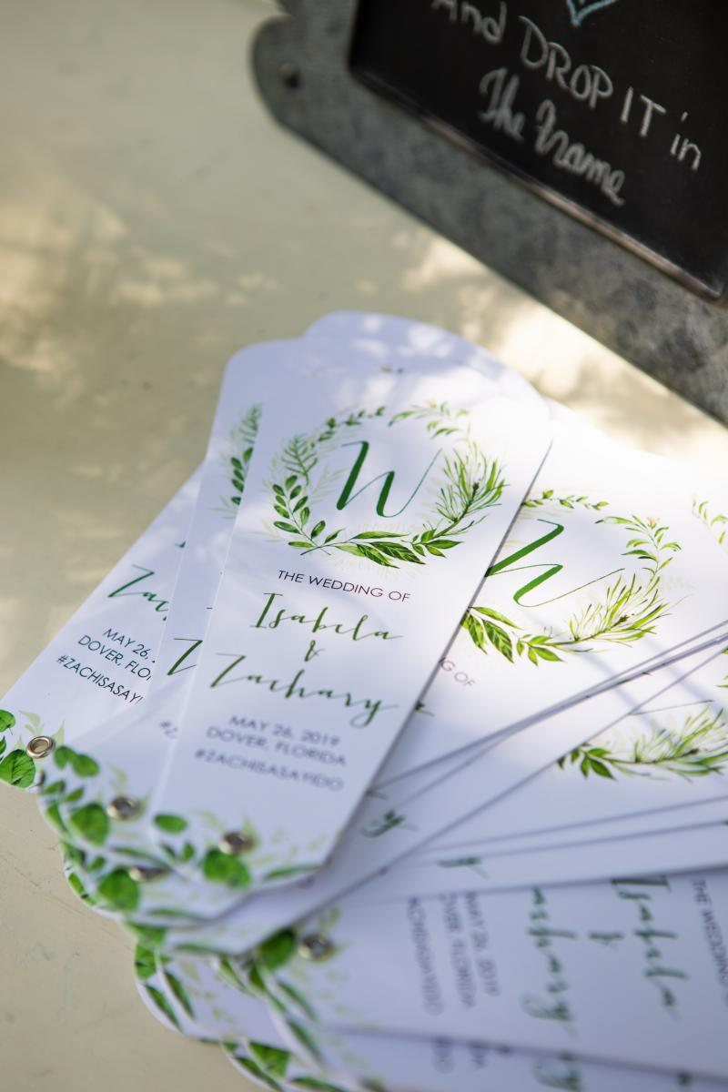 Isabela and Zach's ceremony programs for their darling outdoor I do's