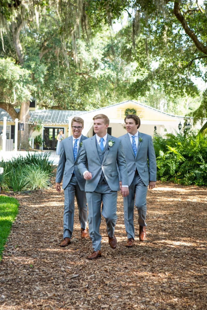 Zach and his groomsmen walking down the aisle