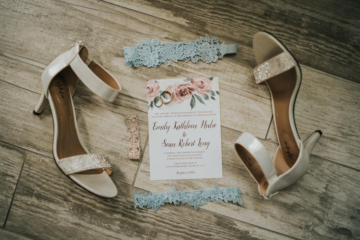 Emily's shoes, garter and their wedding invitation