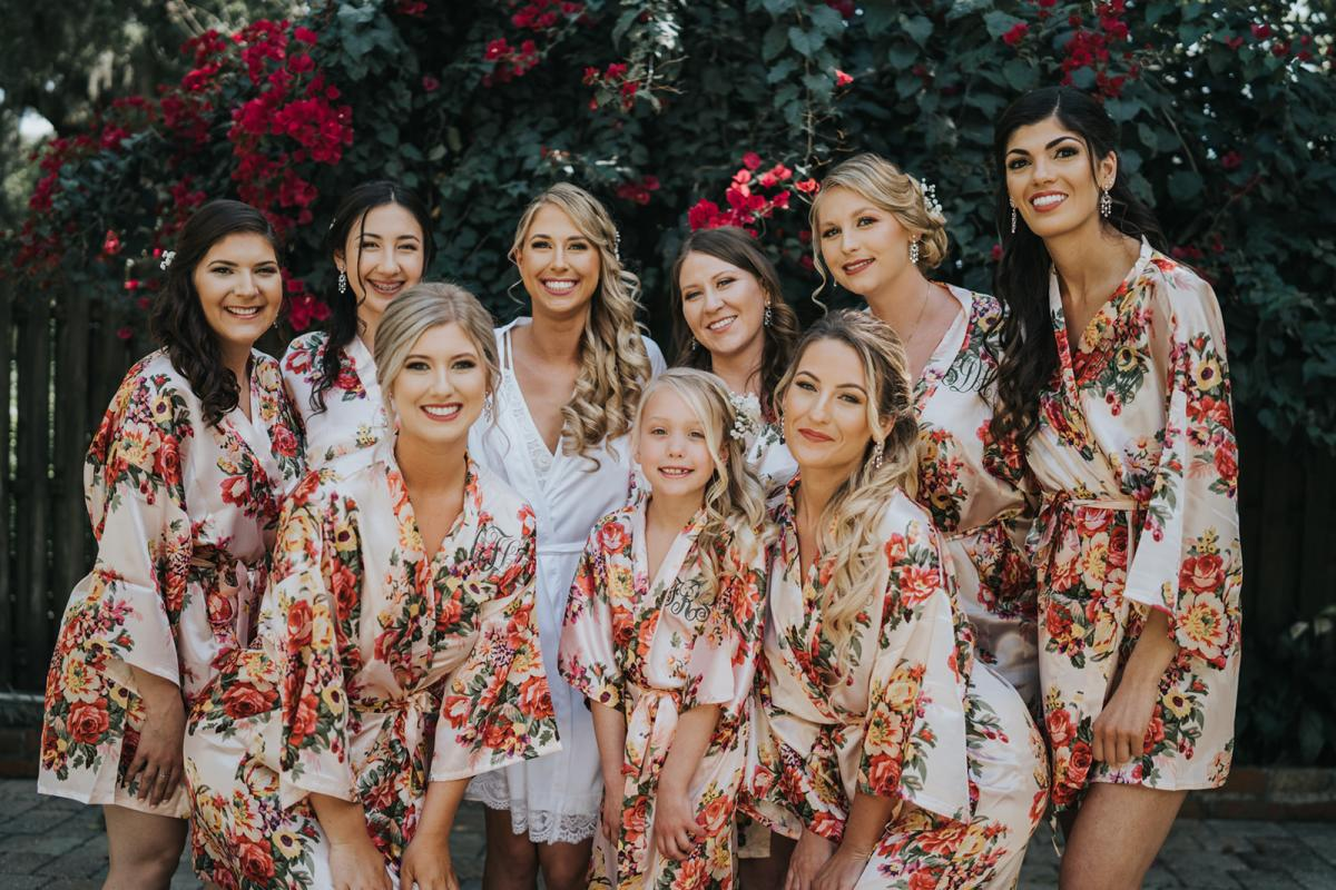 Emily and her bridesmaids in floral robes