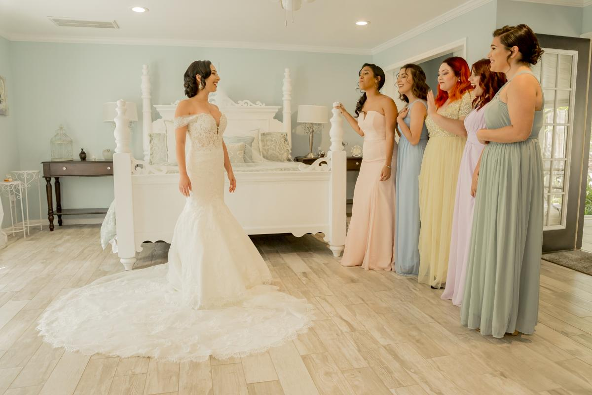 Alexa doing a first look with her bridesmaids