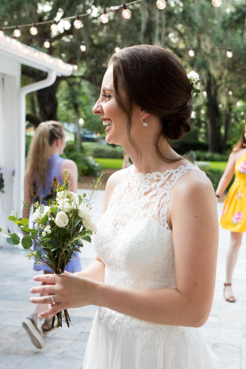 Isabela getting ready to throw her bouquet