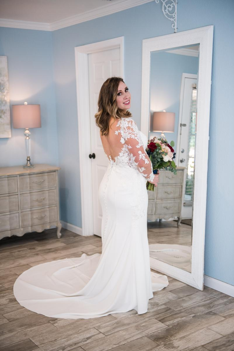 Low back long sleeve wedding gown