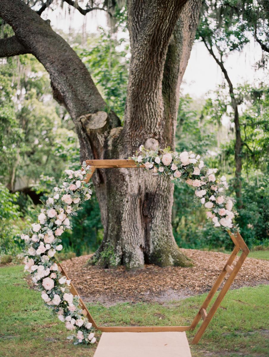 Wooden hexagon arch for a modern Florida ranch wedding