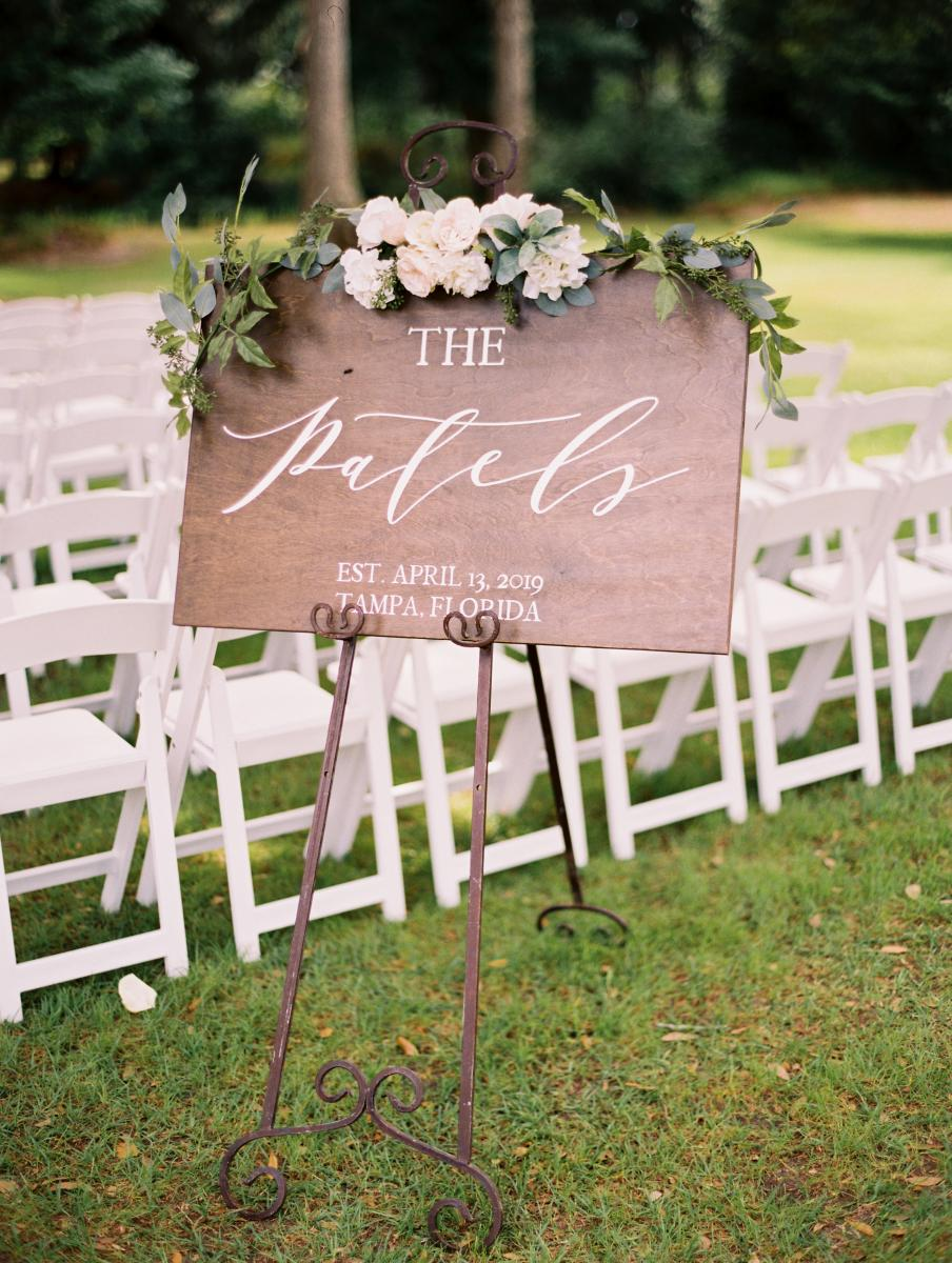 Wooden welcome sign with scripty calligraphy