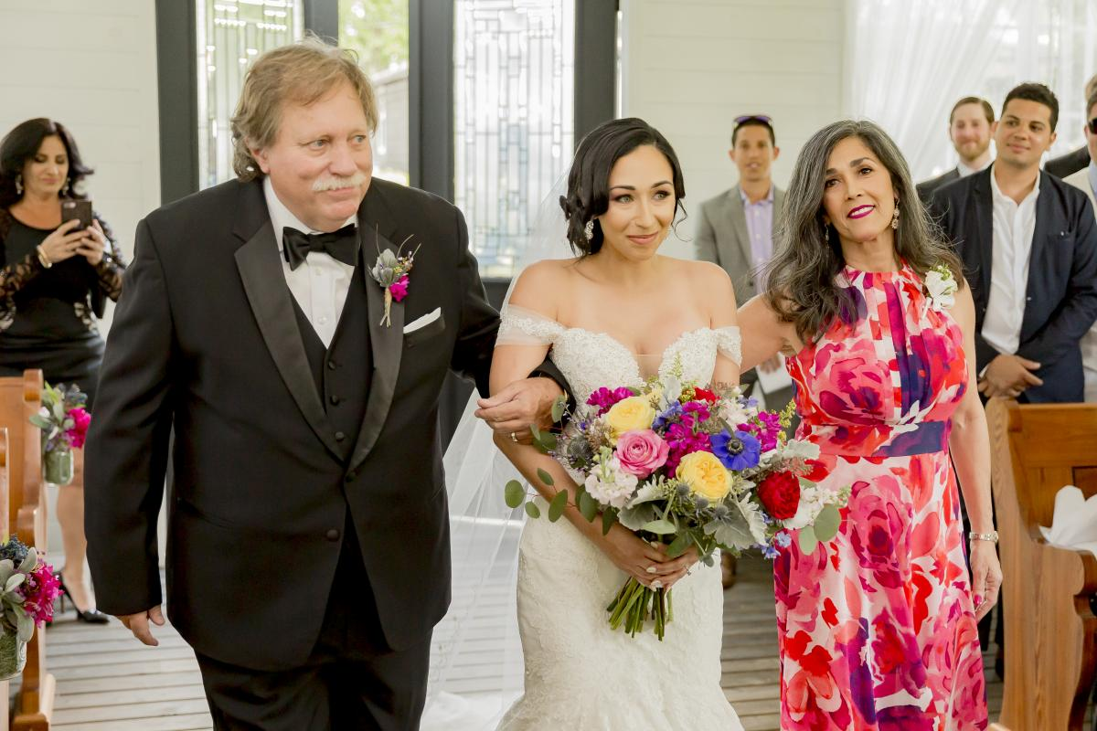 Alexa walking down the aisle with her mother and father
