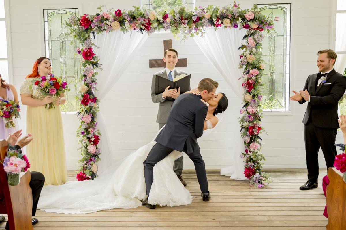 Steven dips Alexa for their kiss after they are pronounced husband and wife