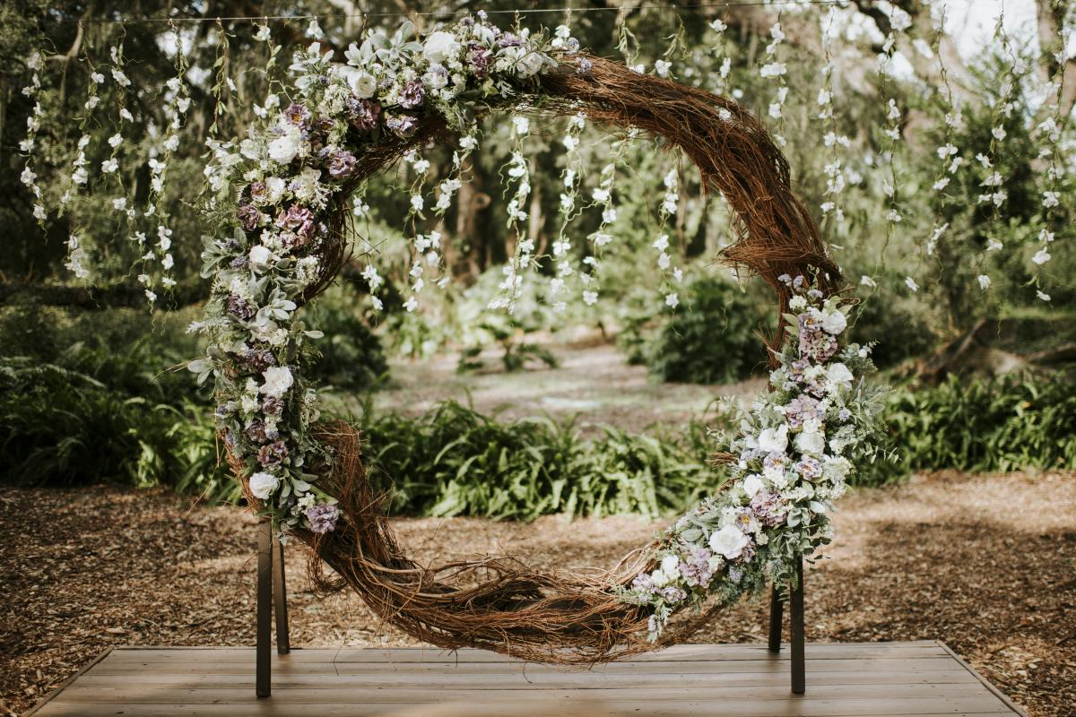 The large grape vine wreath served as the backdrop to Jesse and Paola's wedding ceremony