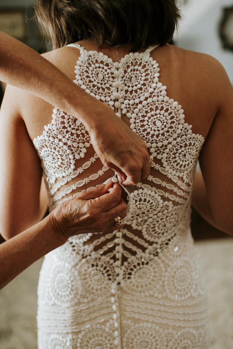 The beaded back of Paola's wedding dress