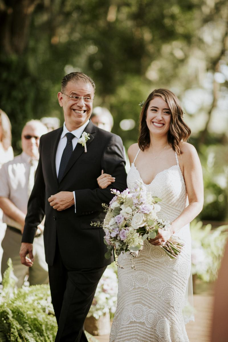 Paola and her dad walking down the aisle