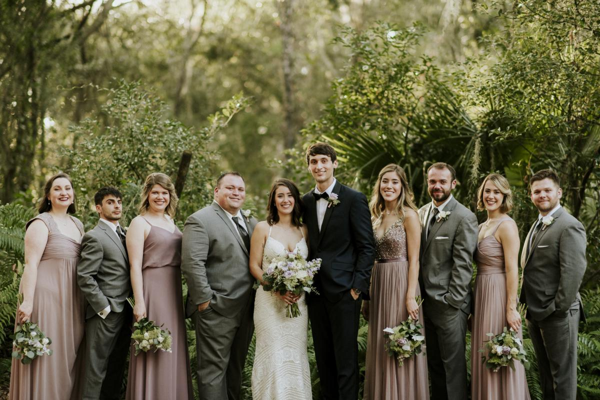 Paola and Jesse with their wedding party