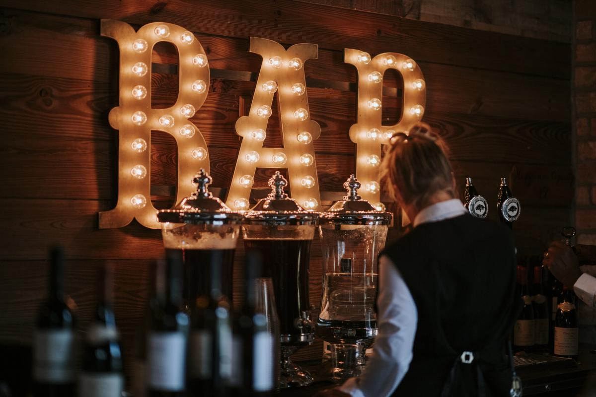 Marquee Bar sign was lit up for their wedding day