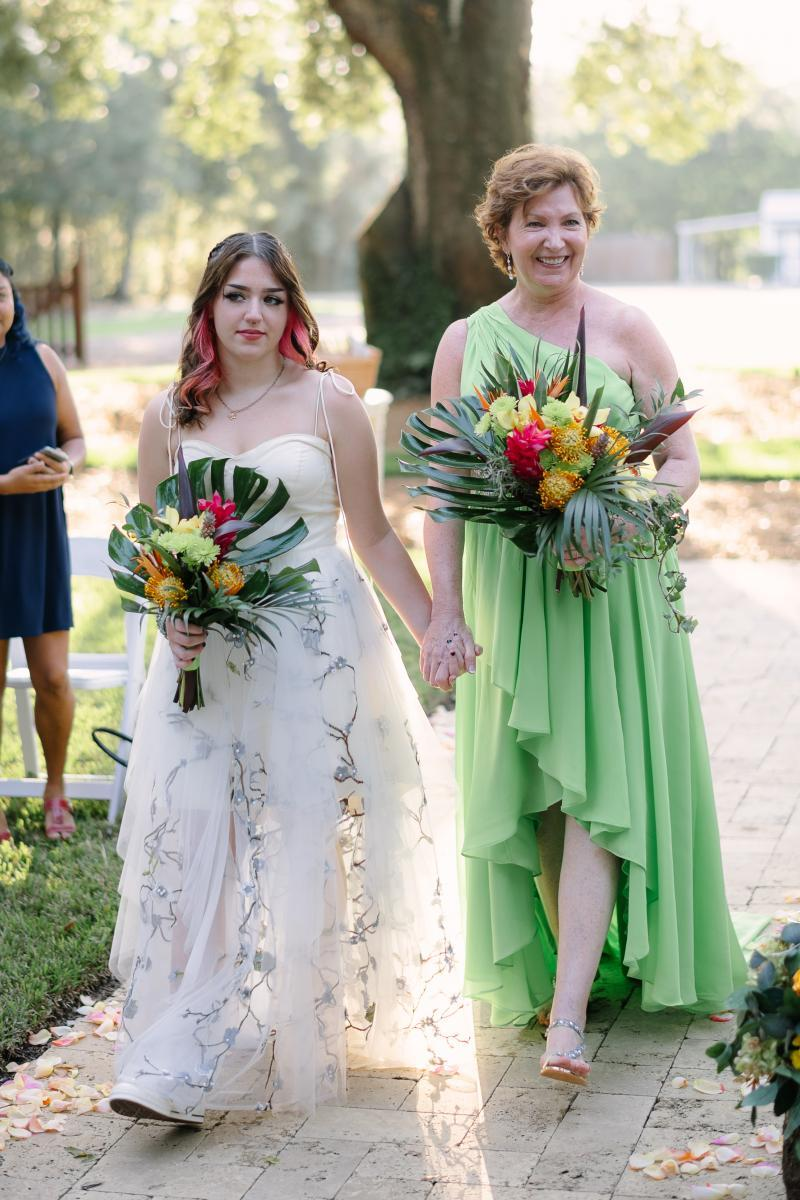 Rita and her granddaughter walking down the aisle