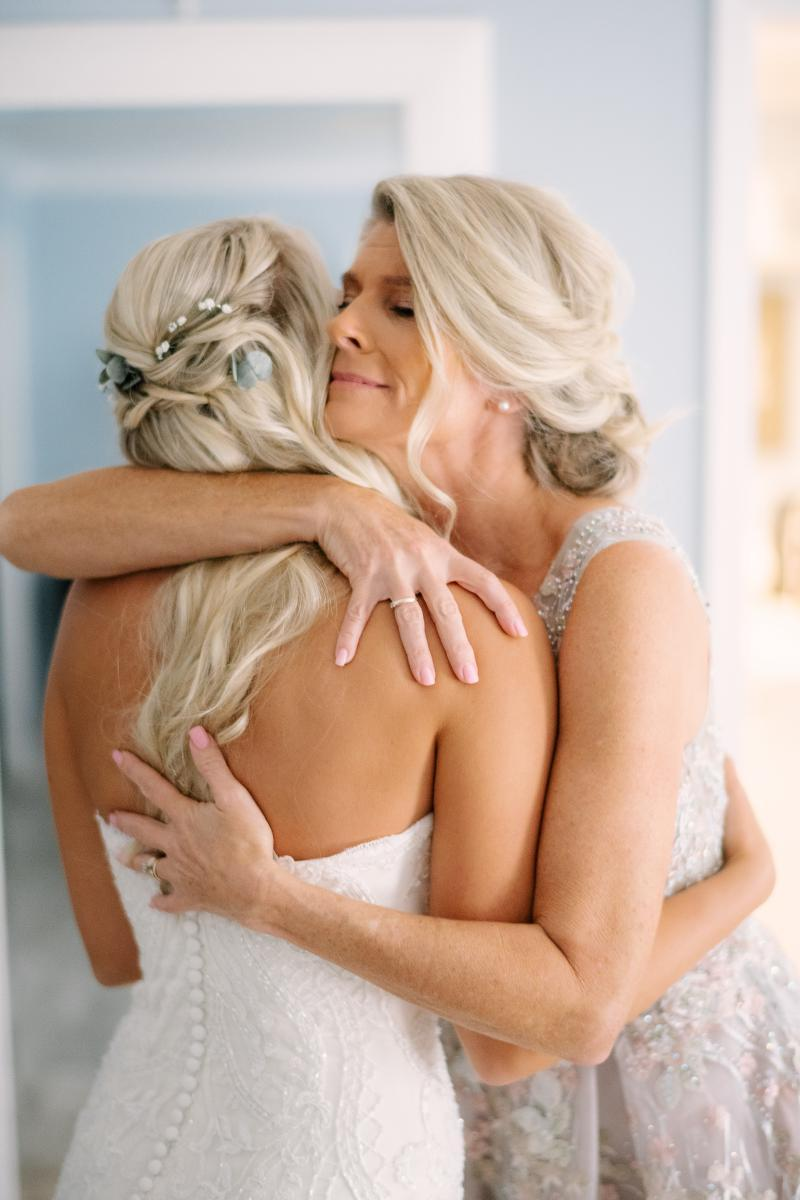 Sweet embrace between a bride and her mother