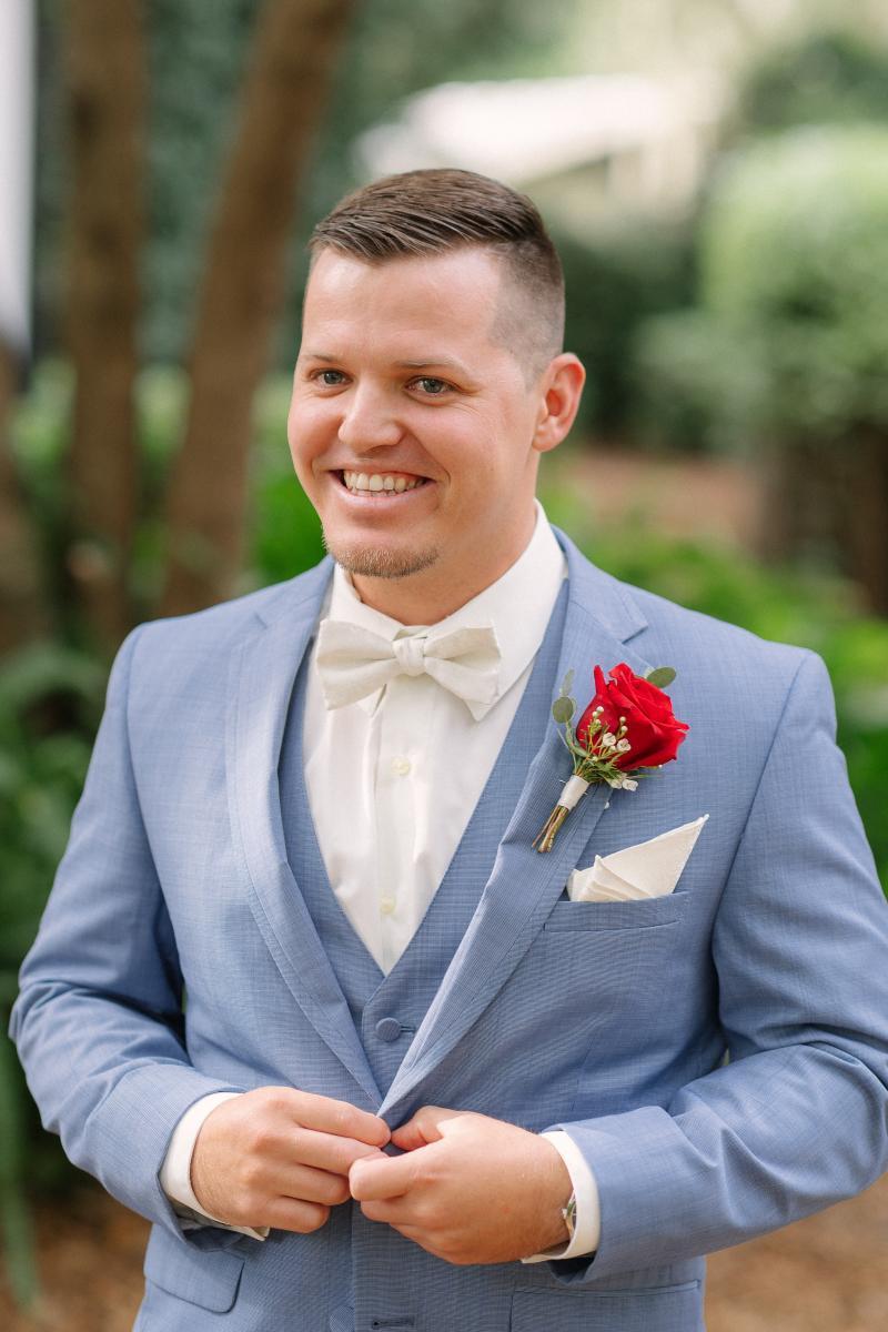 Gage dressed in light blue groom's suit