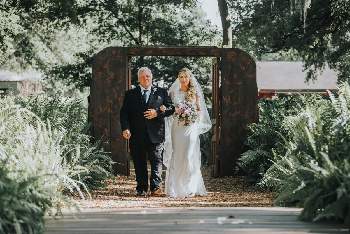 Emily and her father walking down the aisle