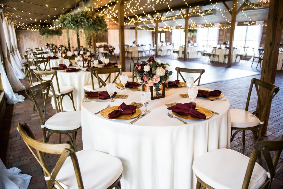 Rustic winter wedding inside a barn wedding venue