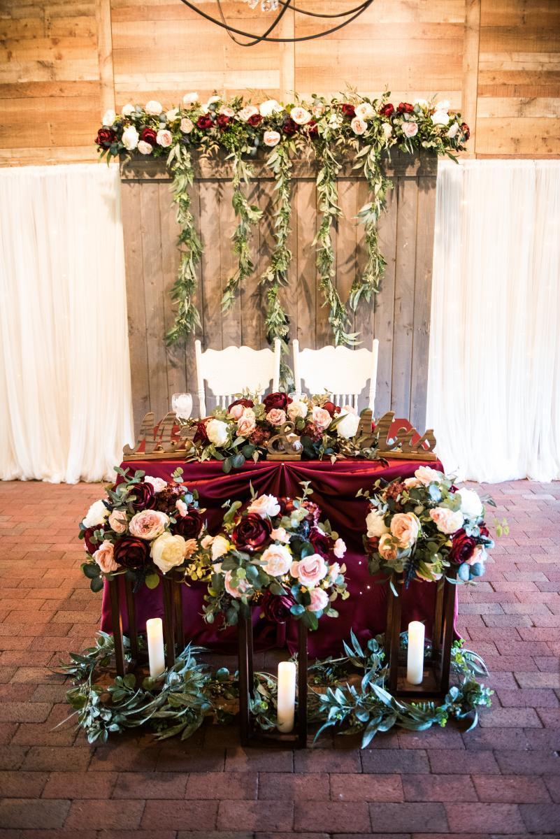 Enchanting rustic wedding sweetheart table