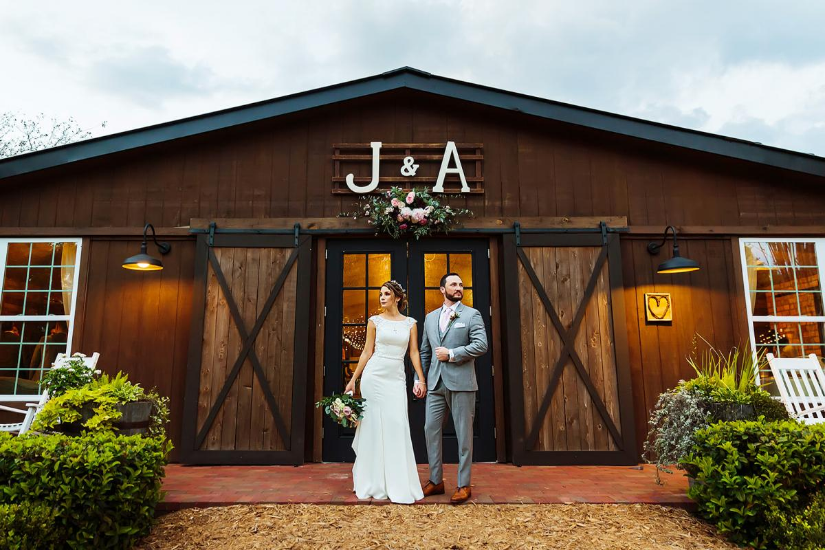 Andreina + John in front of the Carriage House Stable