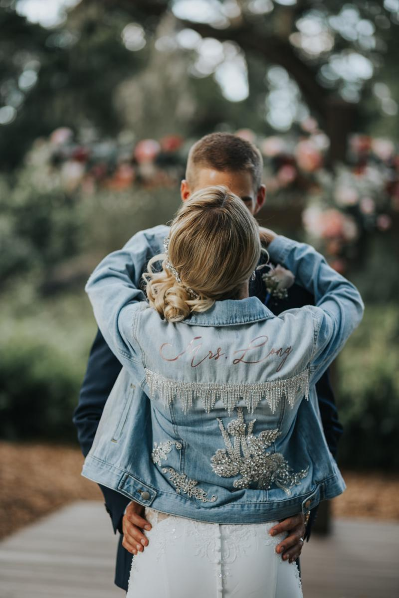 Emily had a custom made jean jacket to wear on her wedding day