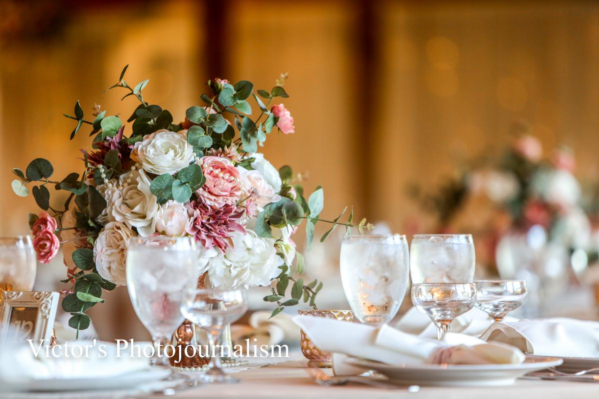 Vintage rose-filled reception centerpieces