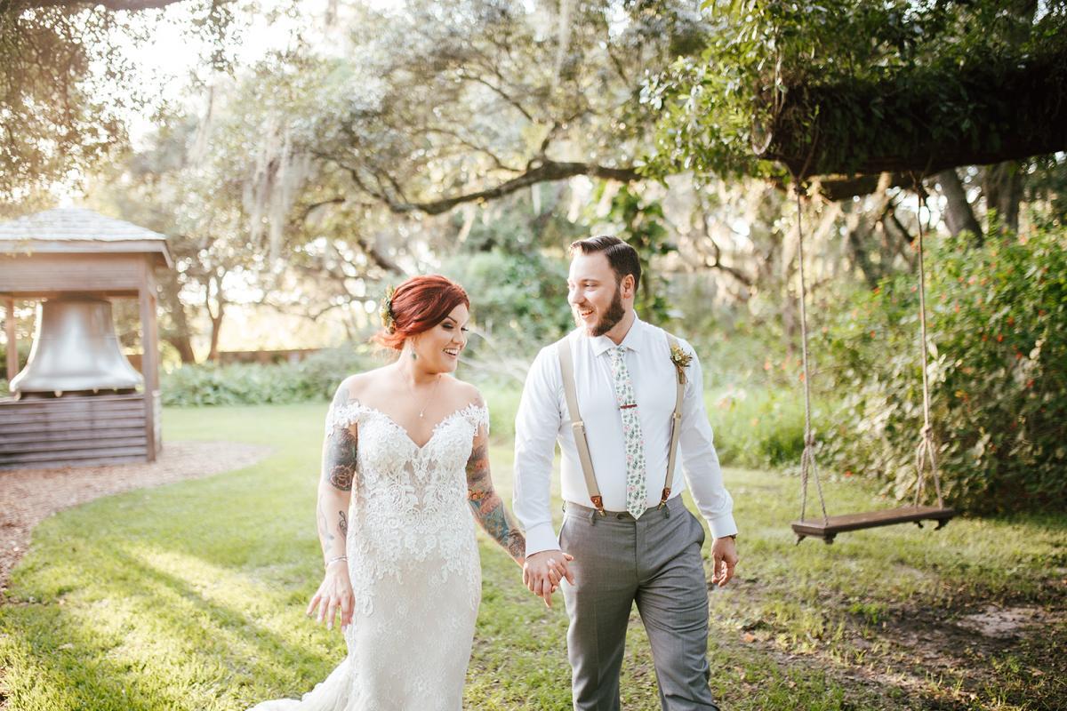 Amanda and Kyle walking hand in hand