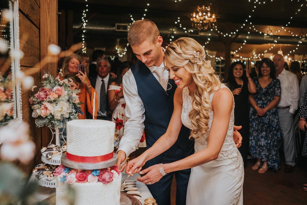 Sean & Emily cutting the cake