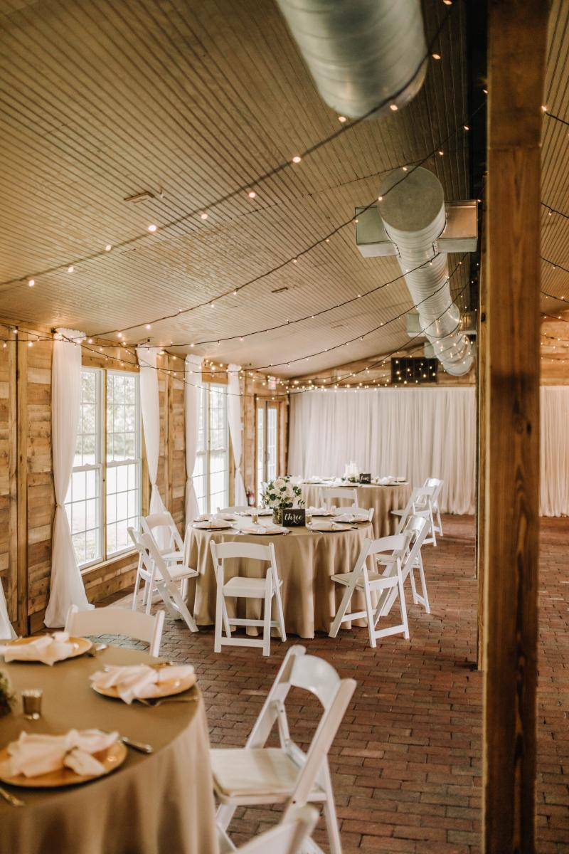 Muted, earthy and rustic wedding tones inside the Carriage House Stable