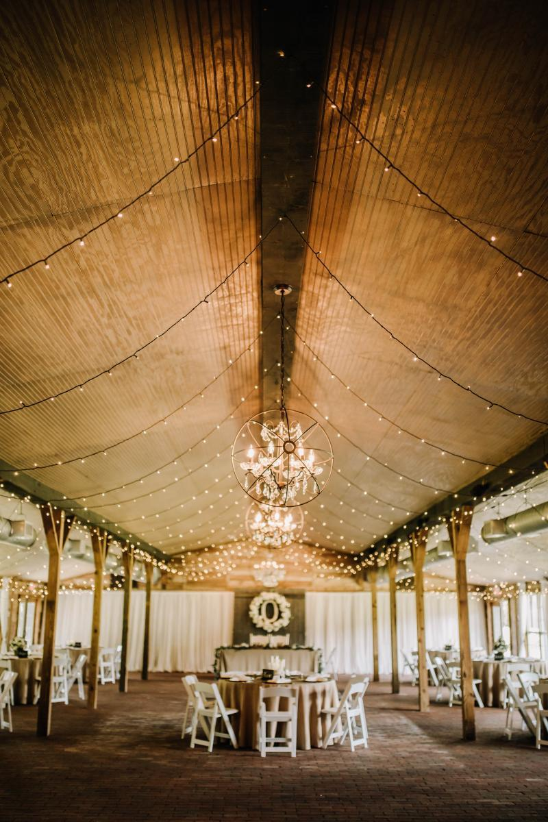 neutral rustic wedding reception at the Carriage House Stable