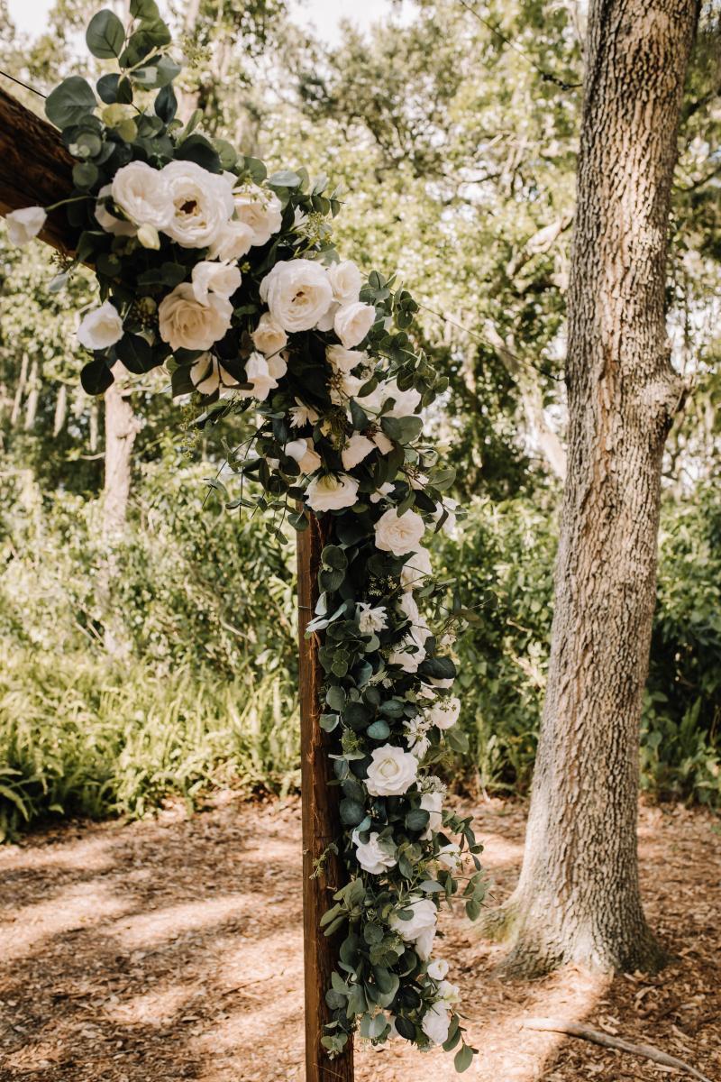 neutral rustic wedding ceremony arch