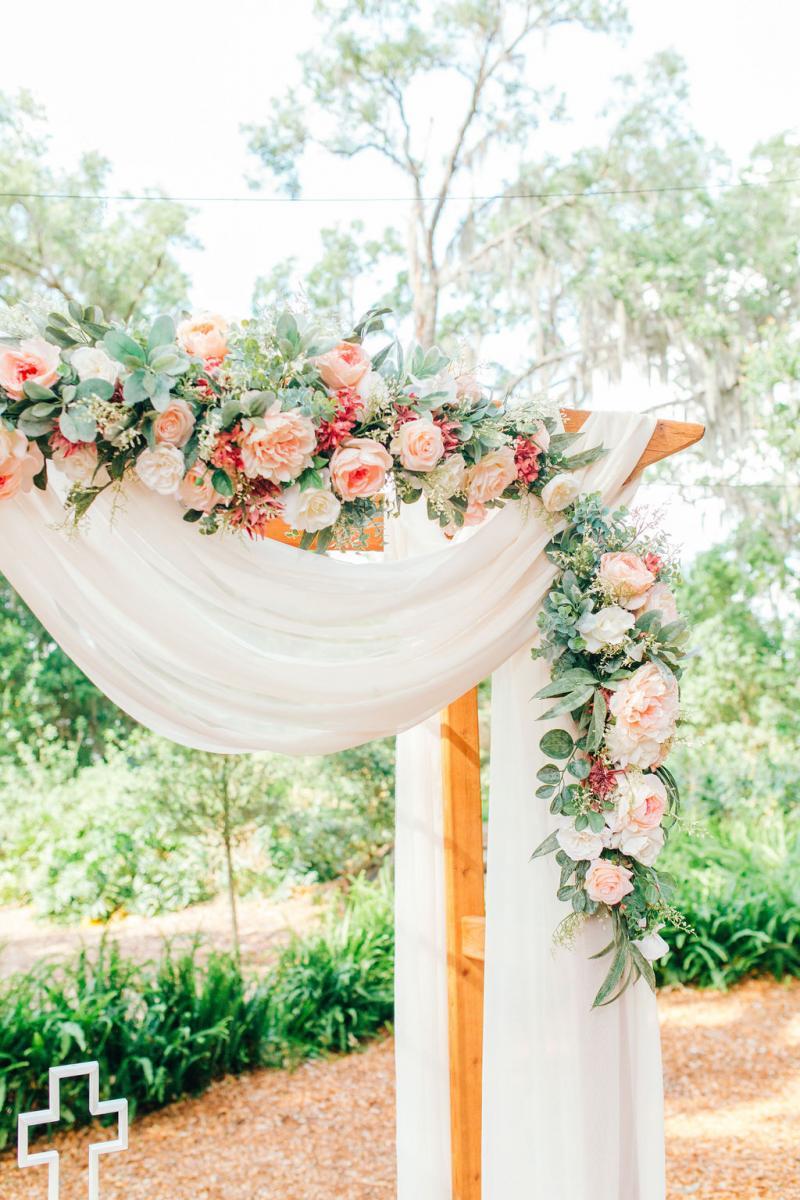 Elegant wedding ceremony arch decor