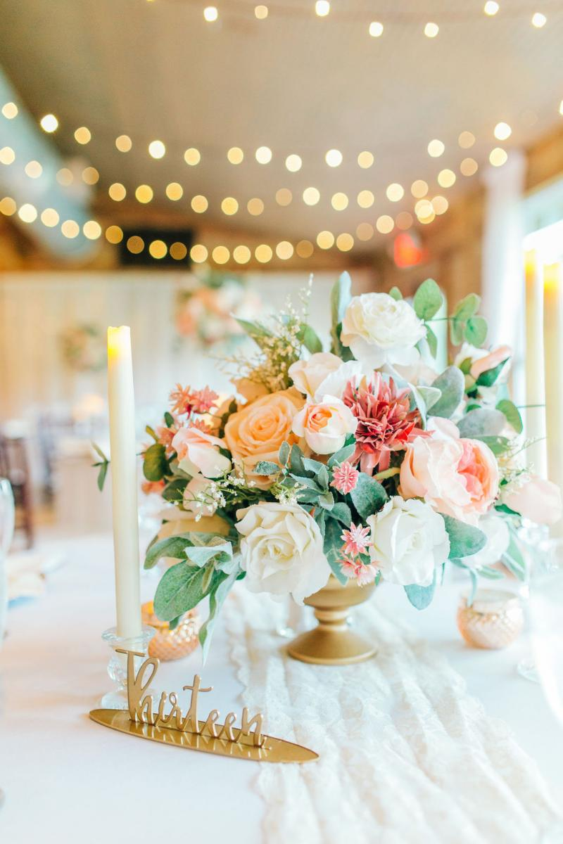 Elegant wedding centerpiece with romantic floral and decor