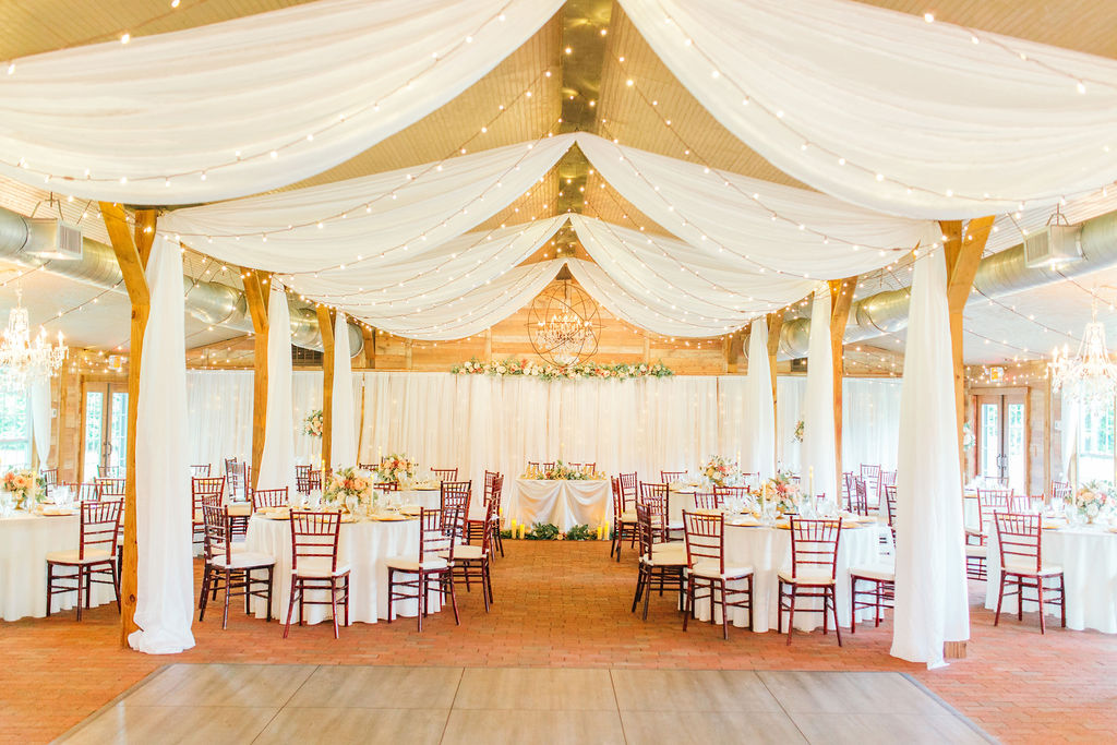 Elegant wedding with romantic draping at the Carriage House Stable