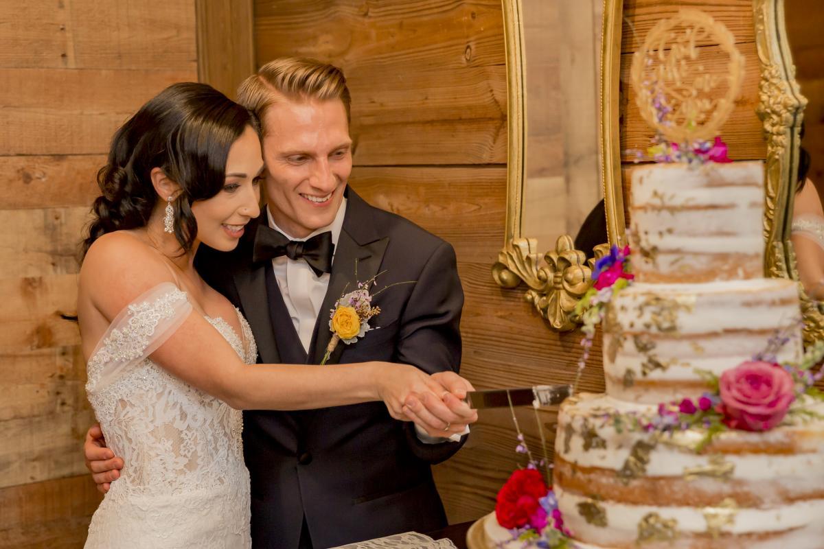 Alexa and Steven cutting the cake