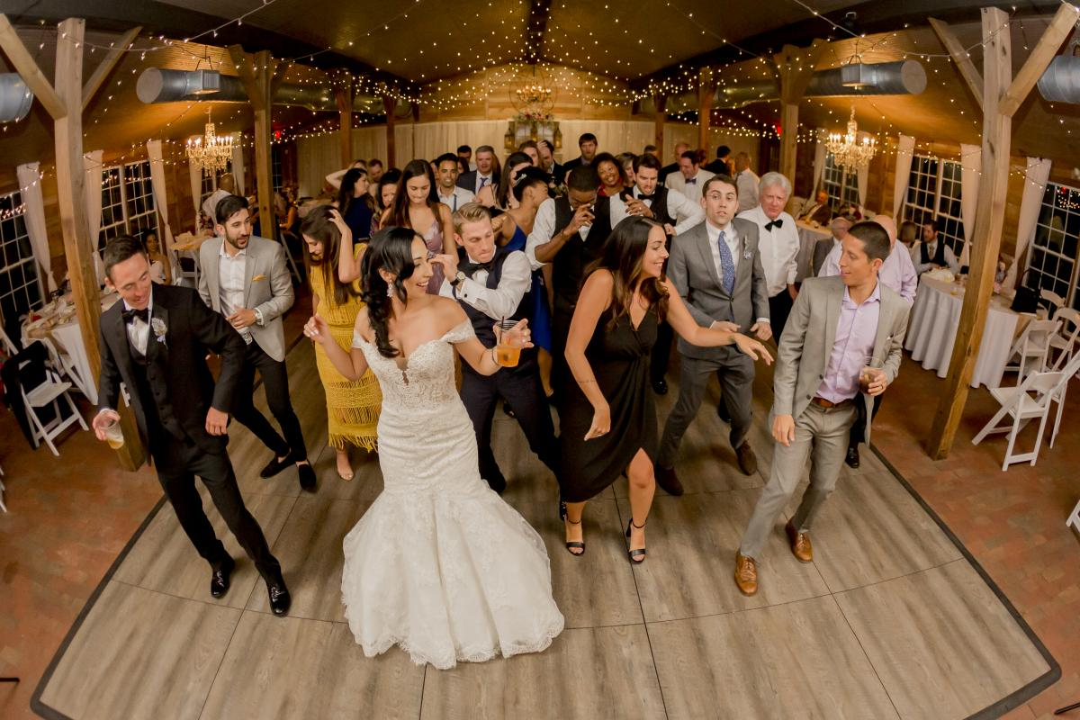 The dance floor was packed for Alexa and Steven's colorful boho wedding