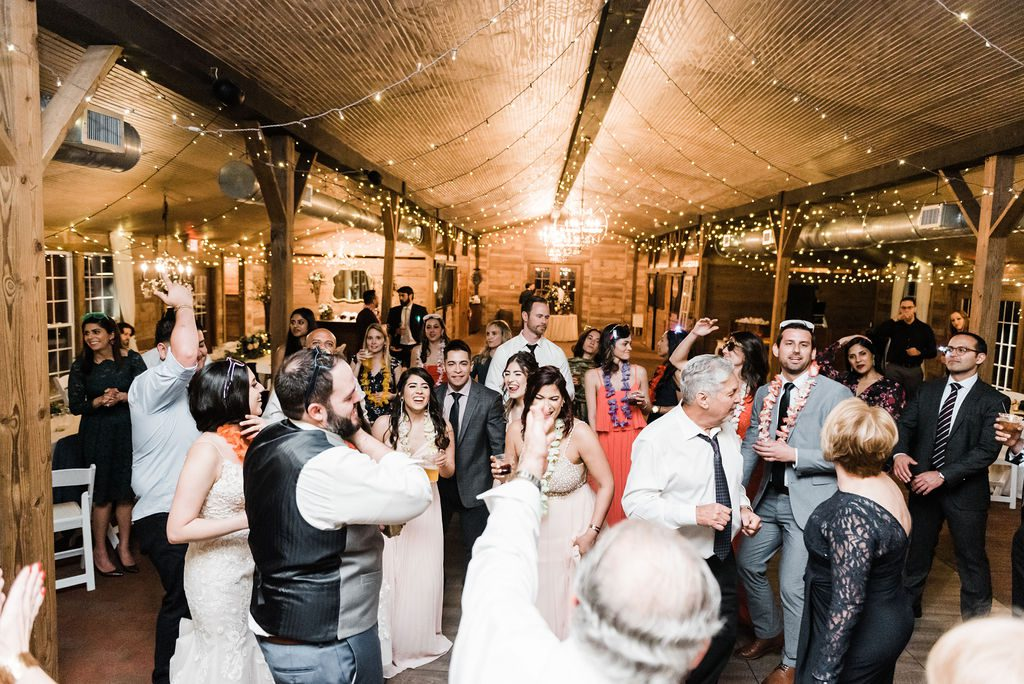 Packed wedding reception dance floor