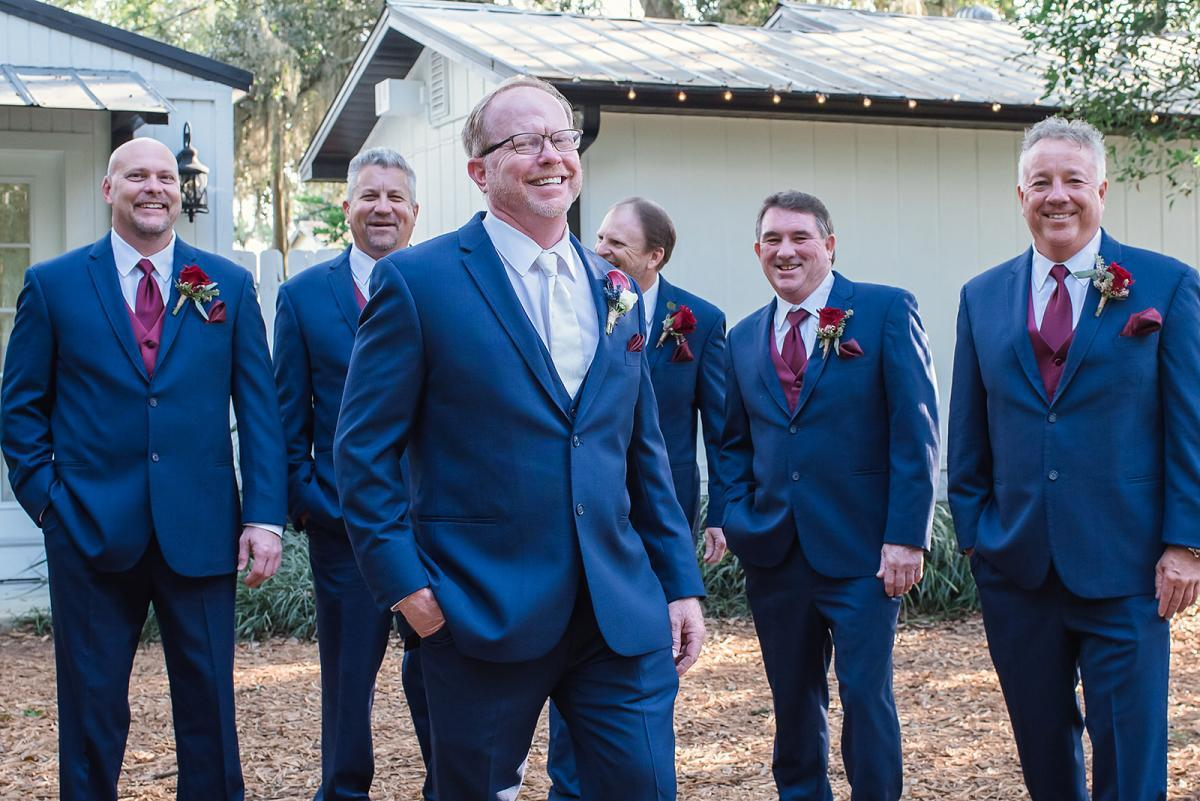 Tim and his groomsmen in navy blue suits