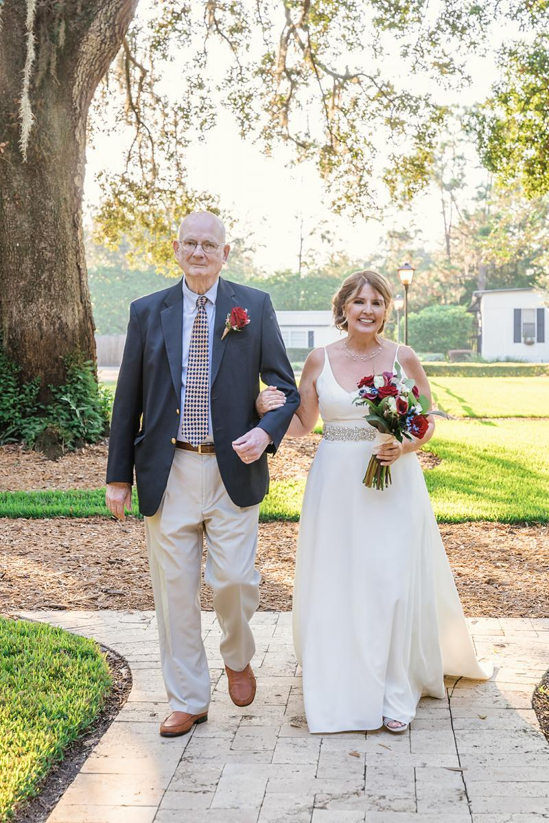Amy and her father walking down the aisle