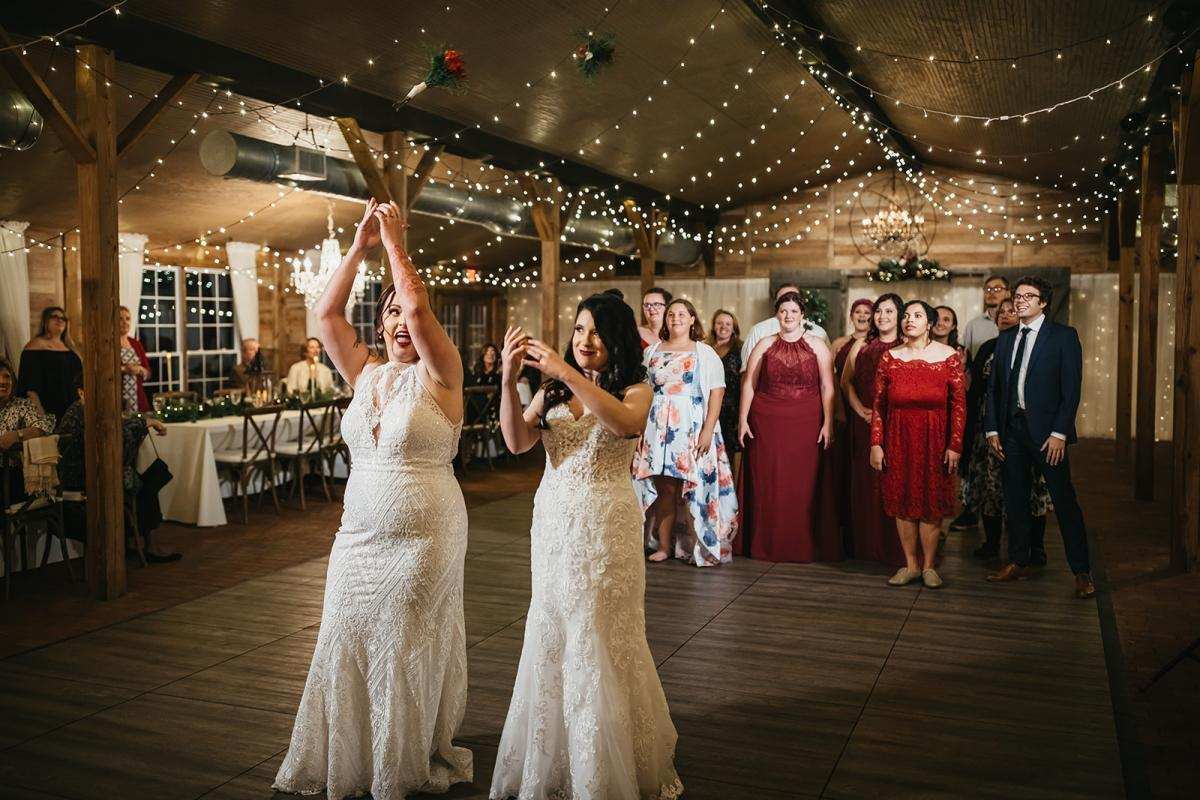 Two brides tossing two bouquets