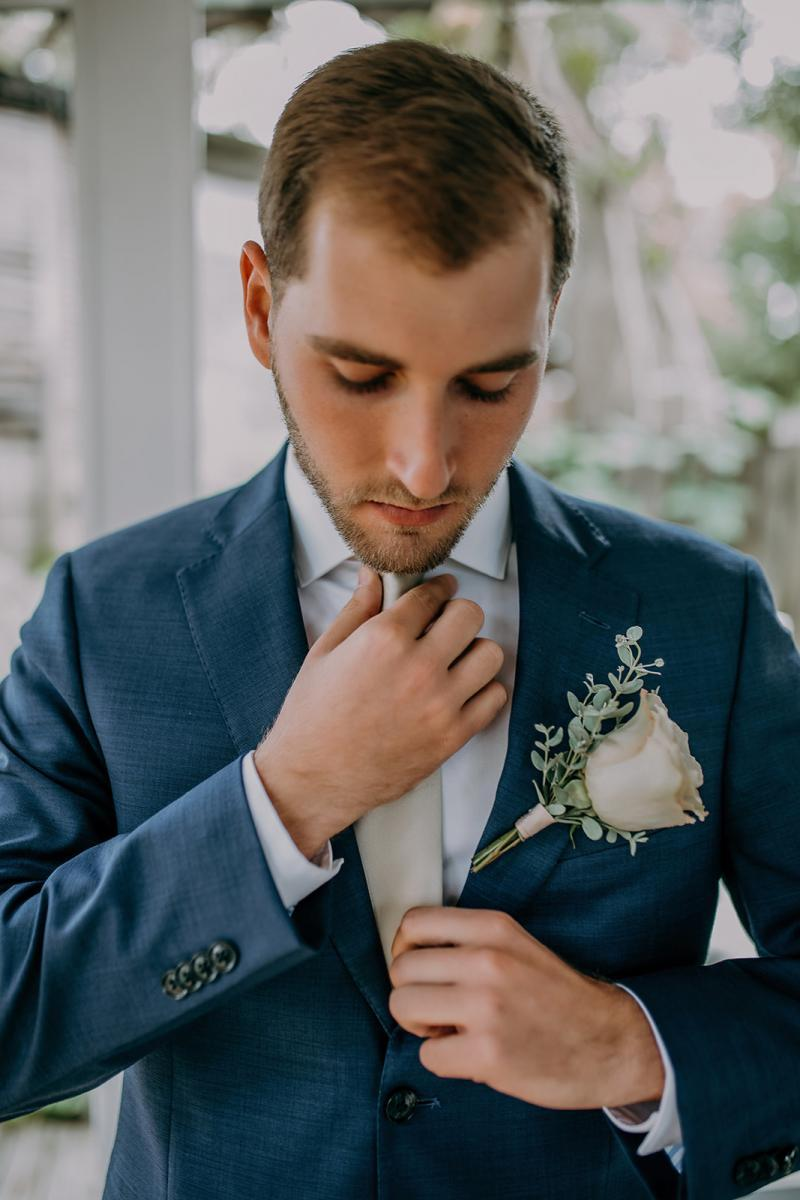 Large rose wedding boutonnieres