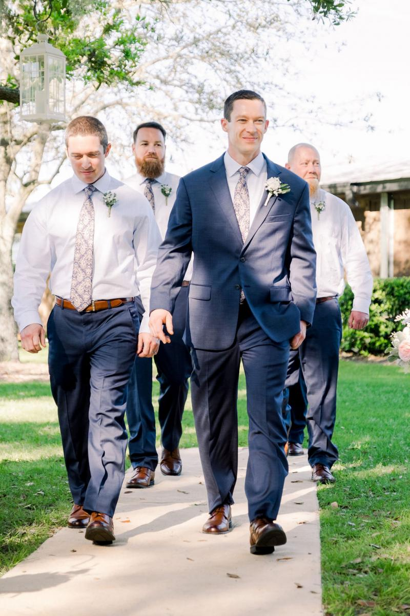 Kevin and his groomsmen walking down the aisle