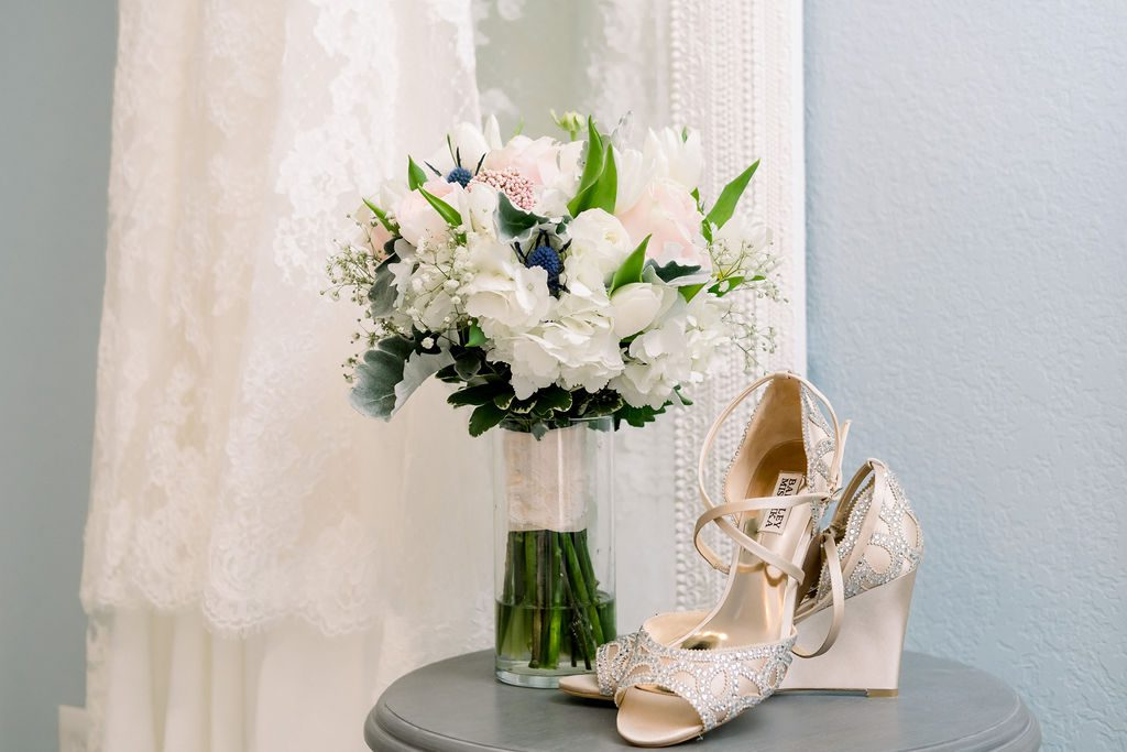 Pam's wedding shoes and bouquet