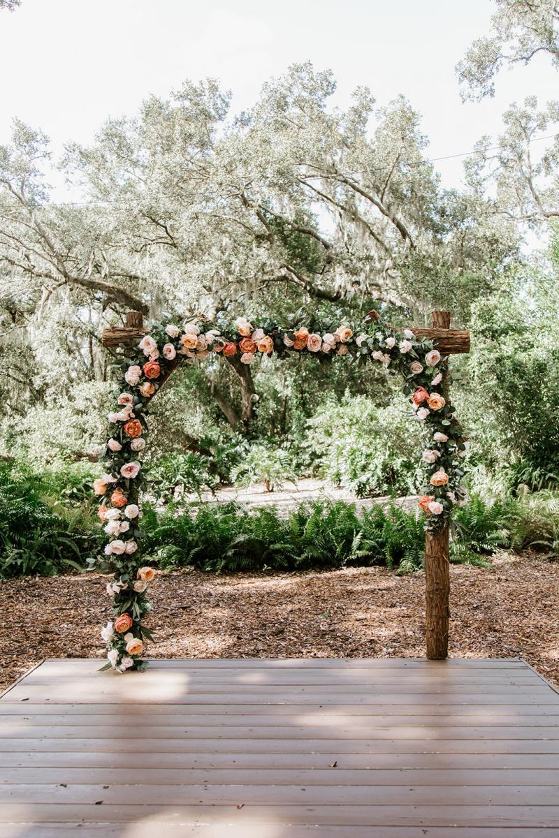 Rustic peach wedding ceremony arch