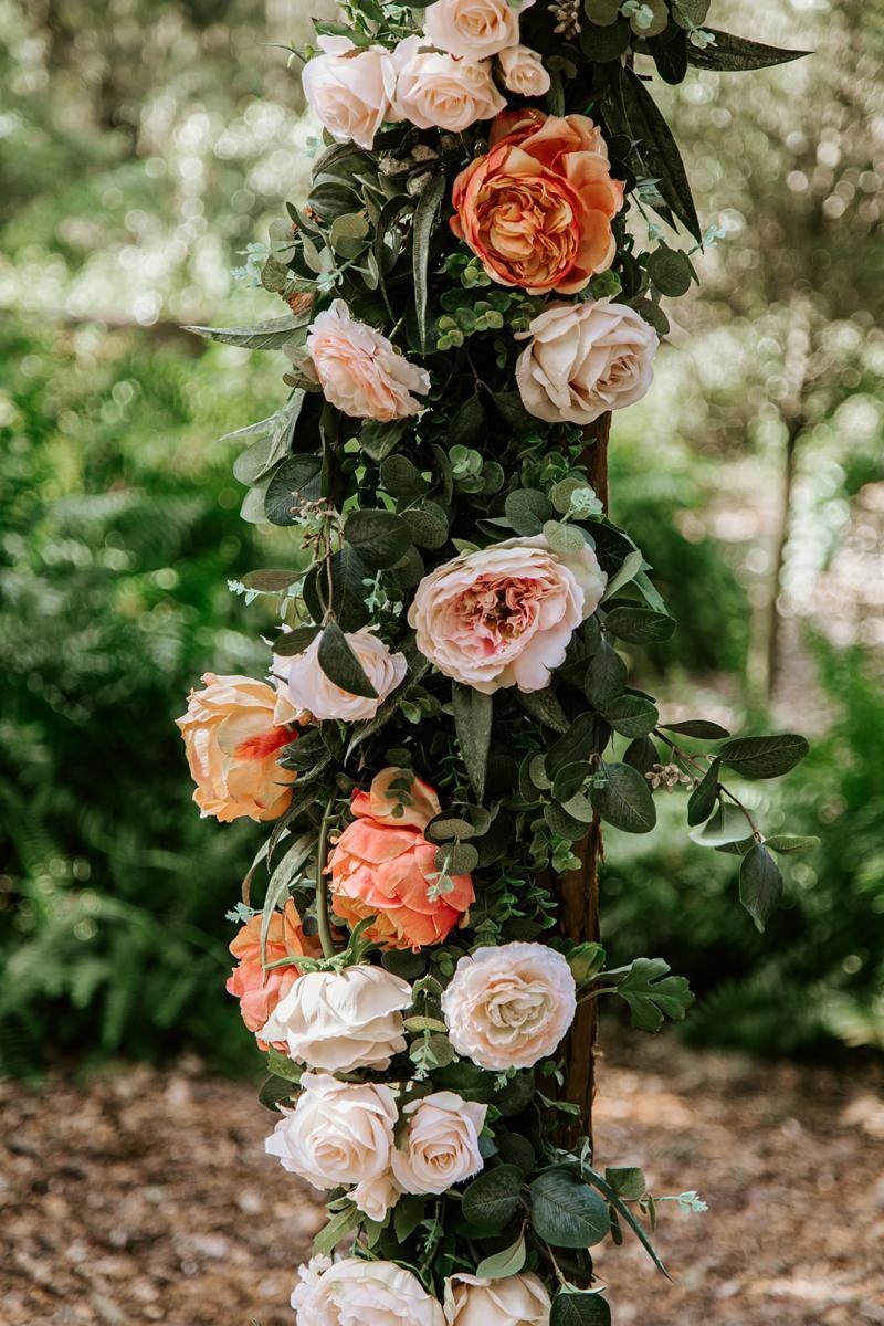 Peach and cream wedding ceremony flowers