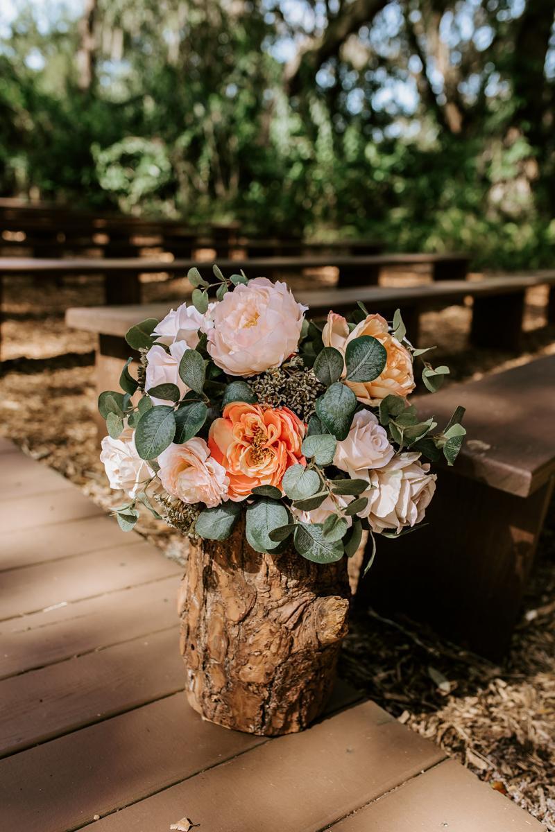 Rustic peach and cream wedding ceremony aisle decor