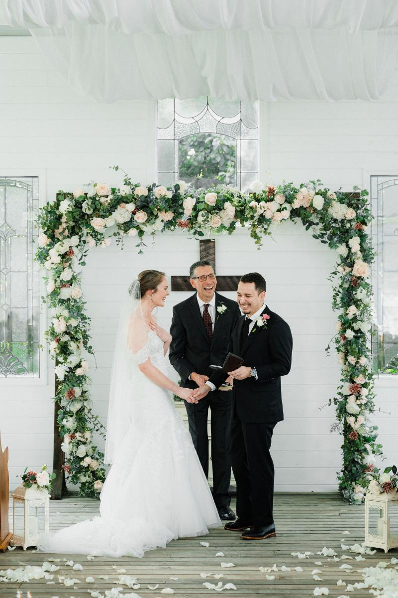 Bride and groom laughing during the ceremony